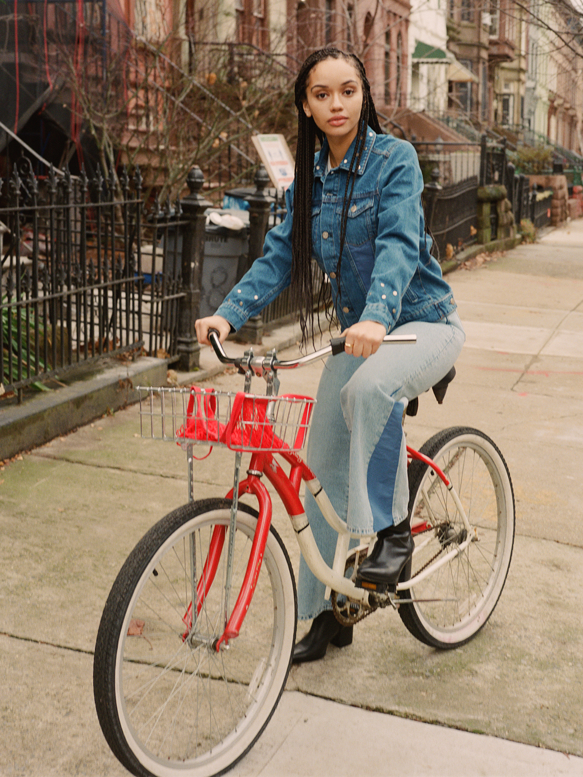 Women riding a bike in a denim outfit from AMENDI