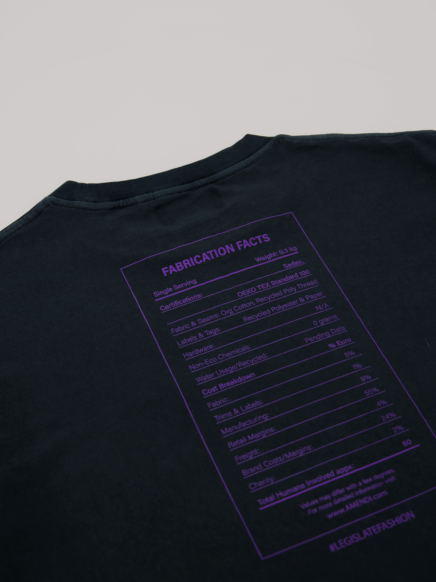 AMENDI black t-shirt with purple text about fabrication facts